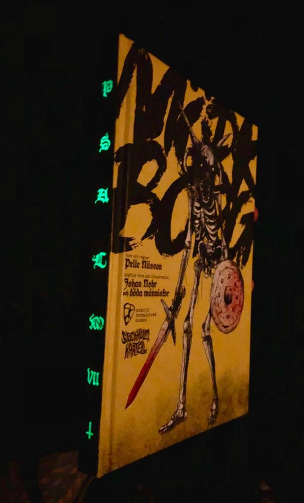 Mörk Borg's glow-in-the-dark spine